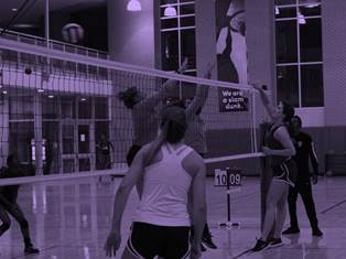 Females playing volleyball at Campus Rec