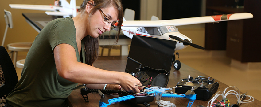 Female student working on drone