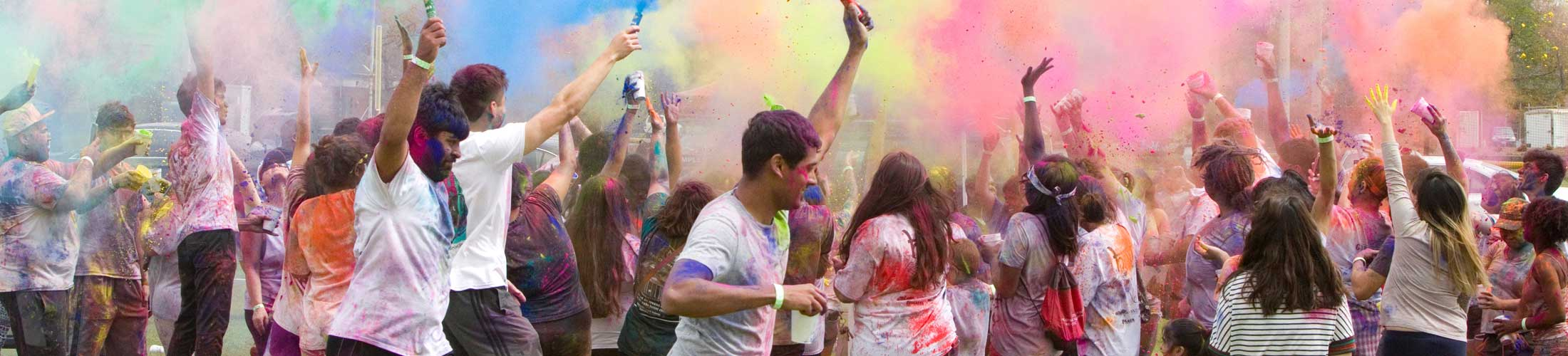 Students throwing color in event