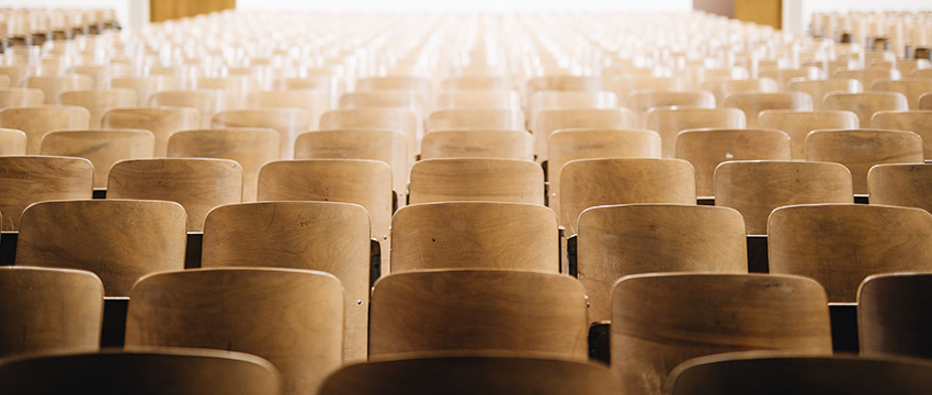 photo of empty chairs in an auditorium