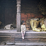 Little girl sitting on steps