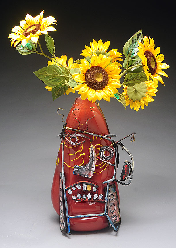 Vase with flowers with art face over it