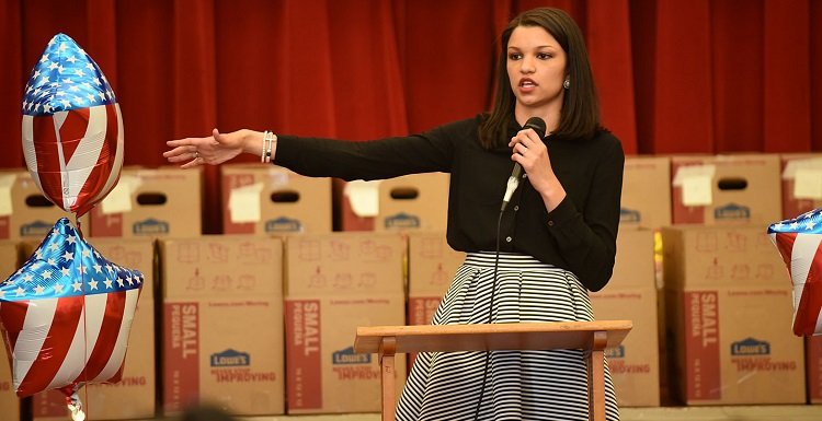 Alicia Duke speaks to students at Dothan's Cloverdale Elementary School about The Little Heroes project. Duke returned to her hometown in April to announce that donated food would help children through the end-of-the-year testing period. Photo courtesy of the Dothan Eagle, photographer Danny Tindel.