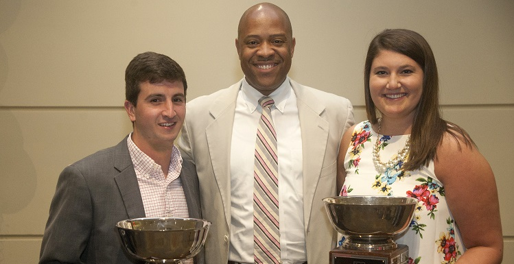 Vice President for Student Affairs and Dean of Students Dr. Michael Mitchell, center, congratulates Dean's Cup winners Sigma Chi Fraternity and Chi Omega Fraternity for women. Joining Mitchell are Drew Tranchina of Sigma Chi and Caitlin Jackson of Chi Omega.