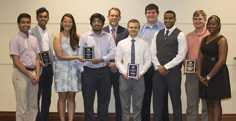 During the 2016 Student Organizations Leadership Awards luncheon, students were recognized for their outstanding service. Congratulating the award recipients are Ravi Rejendra, immediate past president of the Student Government Association, front row far left, and Ashley Ford, far right, SGA student-at-large member.