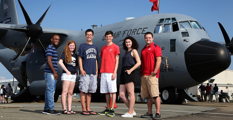 USA meteorology students, from left, Kashawn Sinkler, Peyton Barlow, Cameron Young, Adam Olivier, Alysa Carsley and Jonathan Chance toured a Hurricane Hunters plane during the Gulf Coast Hurricane Awareness Tour on May 19 at Brookley Field.