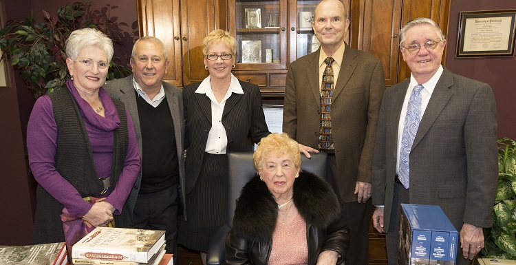 Agnes Tennenbaum, seated, the last known Holocaust survivor in Mobile, visited the USA Marx Library in 2014 for a donation to the Agnes Tennenbaum Holocaust Library Collection. Joining her, from left, Rickie Voit, co-chair, Mobile Jewish Film Festival; Tennenbaum's son, Henry Schwarzberg and his wife, Diane; Dr. Richard Wood, dean, USA Libraries; and Jerry Darring, curator, Alabama Gulf Coast Holocaust Library. Tennenbaum died on Memorial Day.