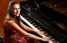 Dr. Robert Holm, professor of music at the University of South Alabama, has been teaching Natalie Newton piano lessons since she was 12.