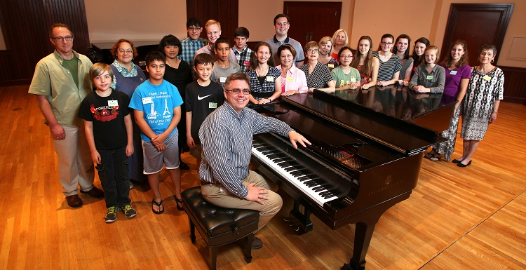 Dr. Holm is surrounded, from left, second row, by Dr. James Helton, guest professor and pianist from Ball State University, Dr. Laura Moore, associate professor of music and director of choral activities at South, and Dr. Sharon Hudson, guest professor of music from the University of Mobile,  along with the piano camp attendees ages 12-adult.