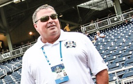 Dr. Joel Erdmann, on the field at TD Ameritrade Park before a game at the NCAA College World Series, has been USA's athletic director since 2009.