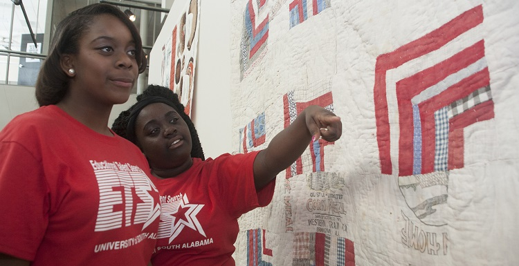 The College of Education and Educational Talent Search at the University of South Alabama recently partnered to introduce the arts into a math and science summer program for middle and high school students. Danielle Johnson, Mary G. Montgomery High School, left, and Yekina Adams, Pillans Middle School, view the Gees Bend quilt exhibit at the Alabama Contemporary Arts Center.