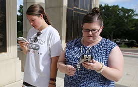 Dr. Stephanie Jett, left, visiting assistant professor of psychology, shares Pokémon Go tips with Susan and Chandler Grimsley at Moulton Tower, where students and others flock to hunt for Pokémon. Susan Grimsley is a 2012 graduate of South with a master's degree in accounting.