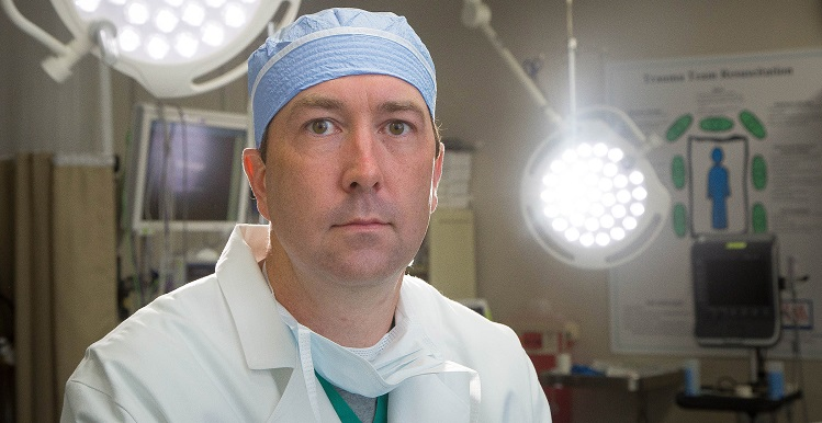 Dr. Jon Simmons, associate professor of surgery at the College of Medicine, balances being a trauma surgeon with an equally passionate curiosity for researching new ways to better treat patients. data-lightbox='featured'