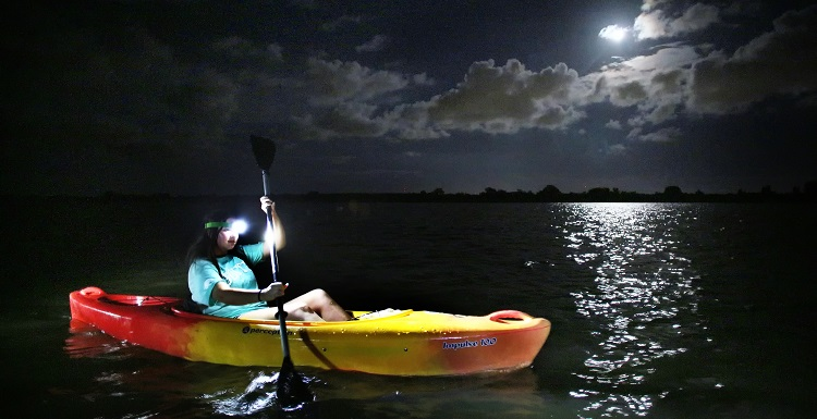Tuesday Scott, a freshman in biomedical sciences, paddles on the Apalachee River in the lower Mobile-Tensaw River Delta during the August Outdoor Adventures full-moon paddle.