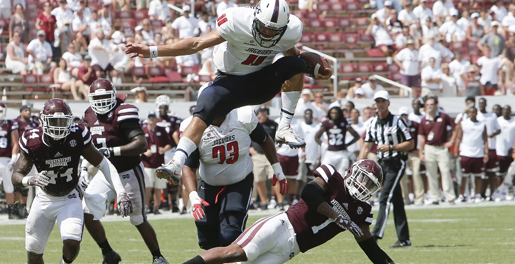 Dallas Davis leaps over Mississippi State defenders in the Jags 21-20 victory in Starkville, Miss.