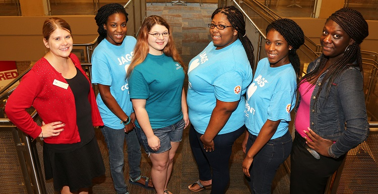 Several of the Members of the Sexual Assault and Violence Educators team, known as SAVE, attend the first session of the Girls' Night Out, violence prevention program held in the Student Center Ballroom. From left are Courtney Diener, Title IX and violence prevention and education specialist, Bria Scott, nursing major; Candace Wilkerson, psychology major; Aisia Snow, speech and hearing major; Taylor Scott and Kadijah Oliver, both professional health science majors.