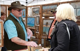 A Mitchell College of Business survey showed more than half of the people attending the Fairhope Arts and Crafts Festival patronized local businesses. Photo courtesy of the Eastern Shore Chamber of Commerce.