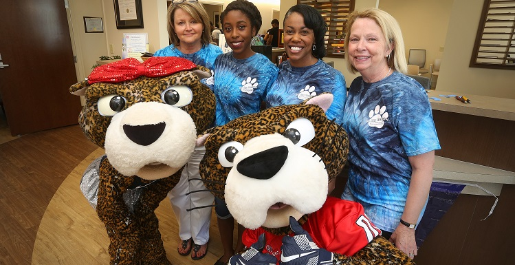 Greeting students in the reception area of the new Student Health Center location during Be Jag Healthy are Miss Pawla and SouthPaw. Second row from left are Valerie Heidel, supervisor of clinical operations; Alexus Banks, president of the student Jag Health Team; FeAunte' Preyear, health education and quality improvement coordinator; and Beverly Kellen, practice director for the Student Health Center.