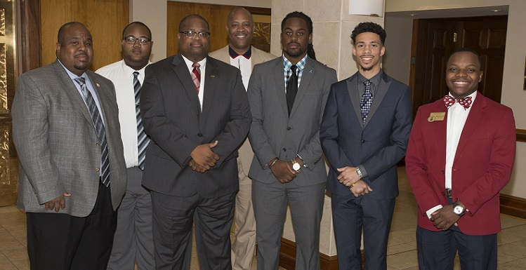 University of South Alabama Collegiate 100 members gather with their mentors from the 100 Black Men of Mobile Inc. From left are Dr. Andre Green, mentor and associate dean in the College of Education; Broderick Morrissette; Marlon Jones; Collegiate 100 mentor and adviser Dr. Michael Mitchell, vice president for Student Affairs and dean of students; Jerod Coleman; Derek Pickett and JuWan Robinson.