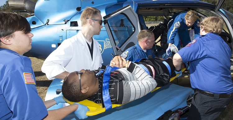 "South students in the emergency medical services program load a ""victim"" onto a helicopter for treatment at a local hospital during an annual disaster drill held Thursday on campus.