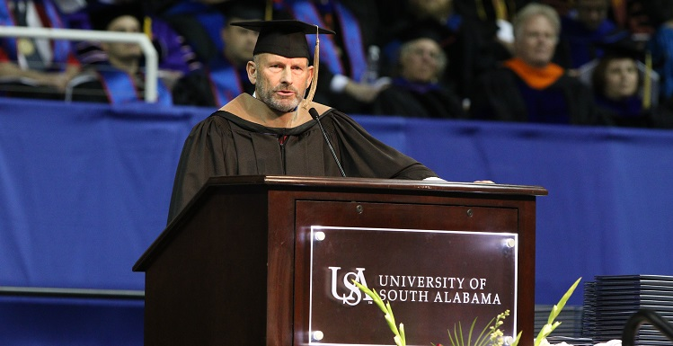 """Retired Coast Guard Vice Admiral William """"Dean"""" Lee's name was the first called Saturday as he led graduates from the College of Arts and Sciences to receive their degrees, then to shake hands with USA President Dr. Tony Waldrop. Lee graduated in 1979 but did not walk, """"something I've always regretted."""""""