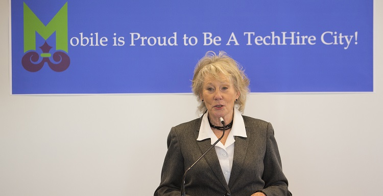 Lynne Chronister, USA vice president for research and economic development, speaks at a news conference designating Mobile as a TechHire Community.