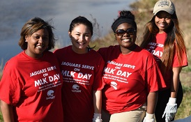 University of South Alabama students participate in a clean-up project Monday as part of the MLK Day of Service.