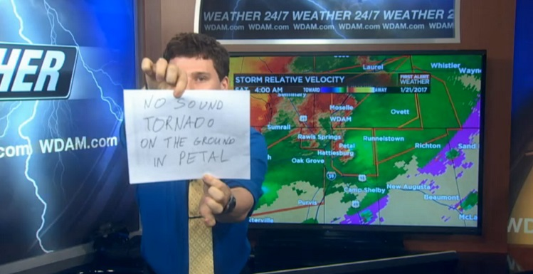 Meteorologist Patrick Bigbie, a 2015 South graduate, used hand-made signs to warn viewers about severe weather when his sound was knocked out.