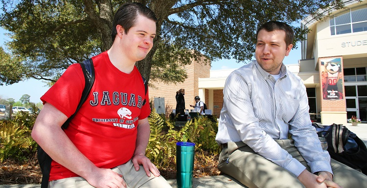 Benjamin Pelham, left, sits with his friend and peer mentor, Josh Overstreet of Bay Minette.