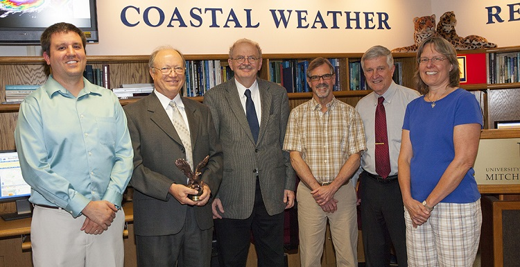 Congratulating Dr. Keith Blackwell, second from left, on his award from CSX were Andrew Murray, instructor of meteorology and Coastal Weather Research Center hurricane specialist; Dr. Andre Wierzbicki, dean of arts and sciences; Pete McCarty, director of the Coastal Weather Research Center; Dr. Bill Williams, director emeritus; and Dr. Sytske Kimball, chair of meteorology.