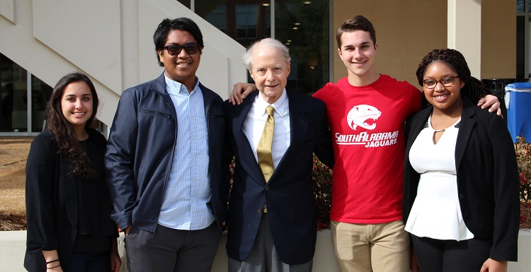 Abe Mitchell, whose gift created a $50 million matching scholarship initiative, meets with, from left, students Alexys Brown, Christian Manganti, Derek Rowan and Raven McShan.