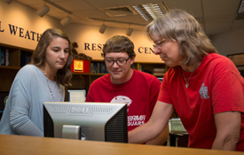 Dr. Sytske Kimball, chair of meteorology, right, discusses research projects with Caroline Kolakoski and Dillon Blount, two of the four South students named as recipients of the prestigious Hollings Scholarships. Caitlin Ford and Sam Sangster are also recipients.