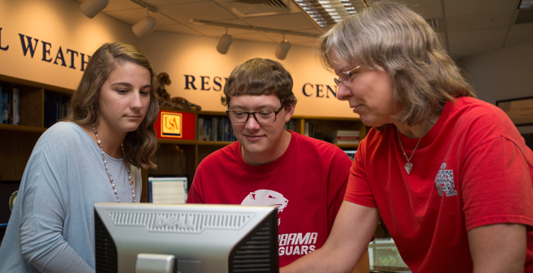 Dr. Sytske Kimball, chair of meteorology, right, discusses research projects with Caroline Kolakoski and Dillon Blount, two of the four South students named as recipients of the prestigious Hollings Scholarships. Caitlin Ford and Sam Sangster are also recipients. data-lightbox='featured'