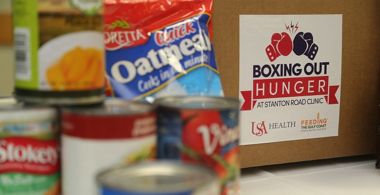 Canned food for Boxing Out Hunger. Through phase one of the Boxing out Hunger program, the Stanton Road Clinic will distribute 1,000 healthy pre-packaged boxes to food insecure patients that contain an assortment of shelf-stable ingredients such as canned produce, protein, dairy and grains.