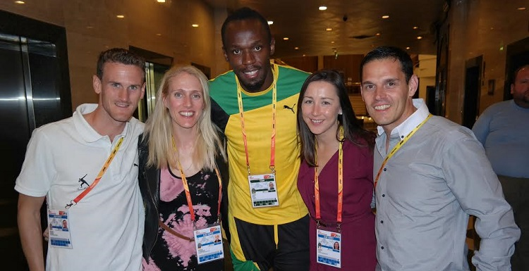 Pace Sports Management representatives, including Gráinne O'Dea, celebrate with Usain Bolt after his win in the 100m at the IAAF World Championships in Moscow in 2013.