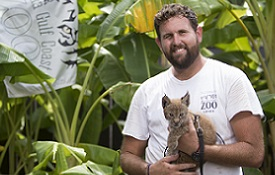 """Austin Everett, a South biology graduate, said he uses his education every day in his job at the Alabama Gulf Coast Zoo. """"With the deeper parts of the job, like knowing your animal's background and physiology, it helps out a huge amount, especially in talking to guests,"""" he said."""