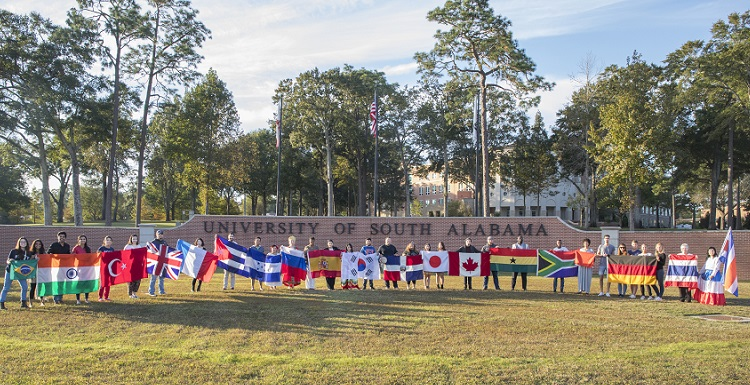 Students representing their home countries gather for a group photo as part of International Education Week.