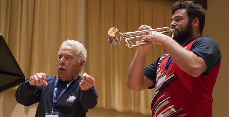 Erick Wricklund, right, a junior music major at the University of South Alabama, plays under the direction of Doc Severinsen, the longtime 'Tonight Show' bandleader.