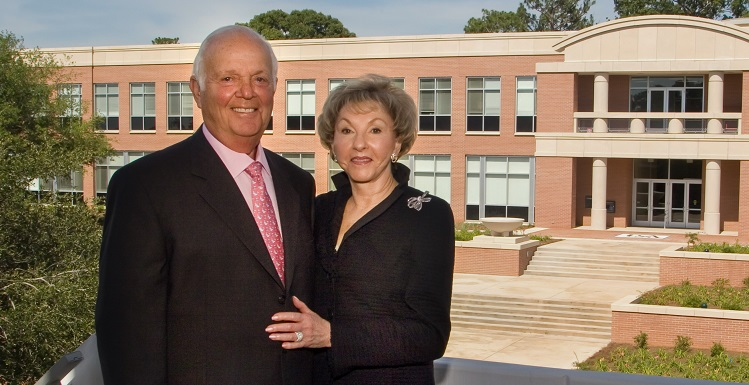 Herbert A. Meisler has donated $5 million to expand the USA Medical Center's Trauma Center, which will be renamed the Fanny R. Meisler Trauma Center. Here, the couple stands in front of Meisler Hall shortly after its construction.