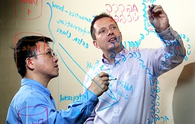 Dr. Jingshan Huang, left, professor of computer sciences, and Dr. Glen Borchert, an assistant professor of pharmacology and biology, are two USA researchers working in the field of informatics. The two have collaborated on projects.