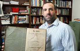 "Dr. David Meola, the Fanny and Bert Meisler Professor of Jewish Studies, holds the journal ""Der Jude,"" created by Dr. Gabriel Riesser and published in the 1830s to advance Jewish emancipation throughout the German states."