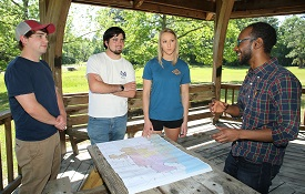 University of South Alabama senior design project team members, from left, Ali Alshehri, Martin Aquirre, Jacob Franklin and Emily Robertson review their redevelopment plans for Stewart Park. Theirs was one of four teams of South engineering students whose senior design project was to redesign components of selected city properties in Mobile.