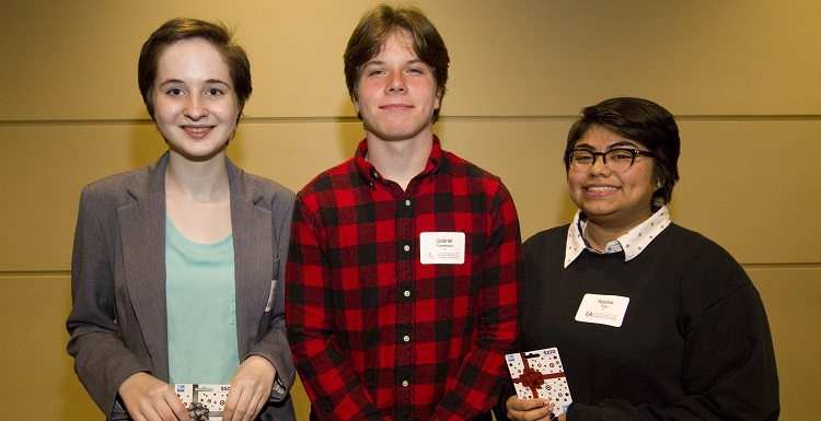 Natalia Trejo, right, received first place in the 2018 High School Public Speaking Contest. Gabriel Robertson, center, came in second, followed by Beata Casiday.