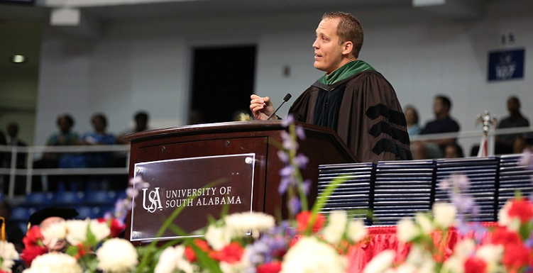 Dr. Tyler Sexton, who completed his residency at the University of South Alabama and is now chair of pediatrics at a Mississippi hospital, spoke to graduates about overcoming obstacles. Sexton was born with cerebral palsy.