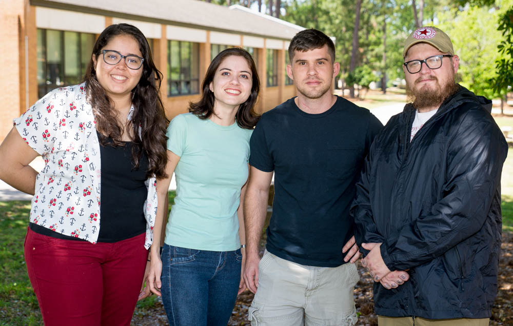 The University of South Alabama was one of only five universities in the United States to participate in a pilot exchange program through the American Association of State Colleges and Universities. From left, Ilza de Oliveira Feitosa Passos and Jéssica Campêlo de Sá visited Mobile for two months, and South students Eric Anderson and Dale Pate in turn will travel to Brazil.