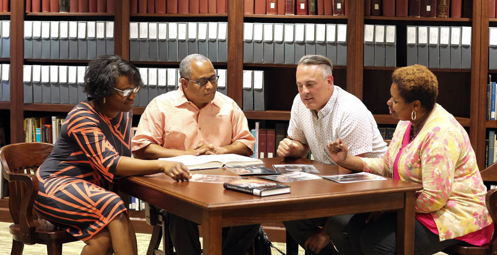 The life and legacy of Clotilda survivors of Africatown will be included in the first feature documentary film with the collaborative efforts of faculty from the University of South Alabama and Spring Hill College. Discussing resources for the documentary are, from left, Dr. Joel' Lewis Billingsley, producer; Dr. Kern Jackson, co-producer; Ryan Noble, director; and Dr. Pamela R. Moore, co-producer.