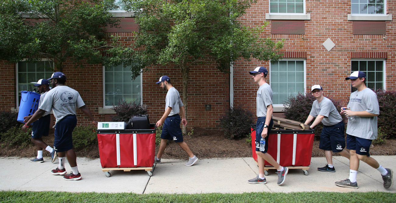 Members of the Jaguar Marching Band were among the students, faculty and staff who helped freshmen move in to their on-campus homes. Here they are in front of Epsilon Hall.  data-lightbox='featured'