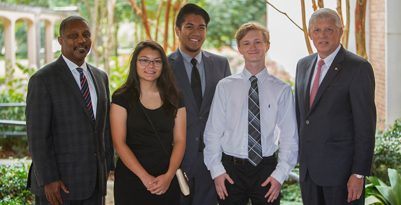 Board of Trustees Chair Pro Tempore Ken Simon, far left, along with other trustees recognized the 2018 Board of Trustees Scholar Cody Dunlap, second from right, at their fall meeting. Also attending were, from left, Ada Chaeli van der Zijp-Tan, 2017 recipient; Christian Manganti, 2016 recipient; and Dr. Tony Waldrop, University president.