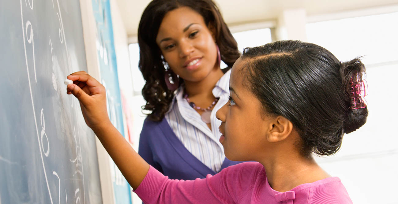 stock image of teacher and student data-lightbox='featured'