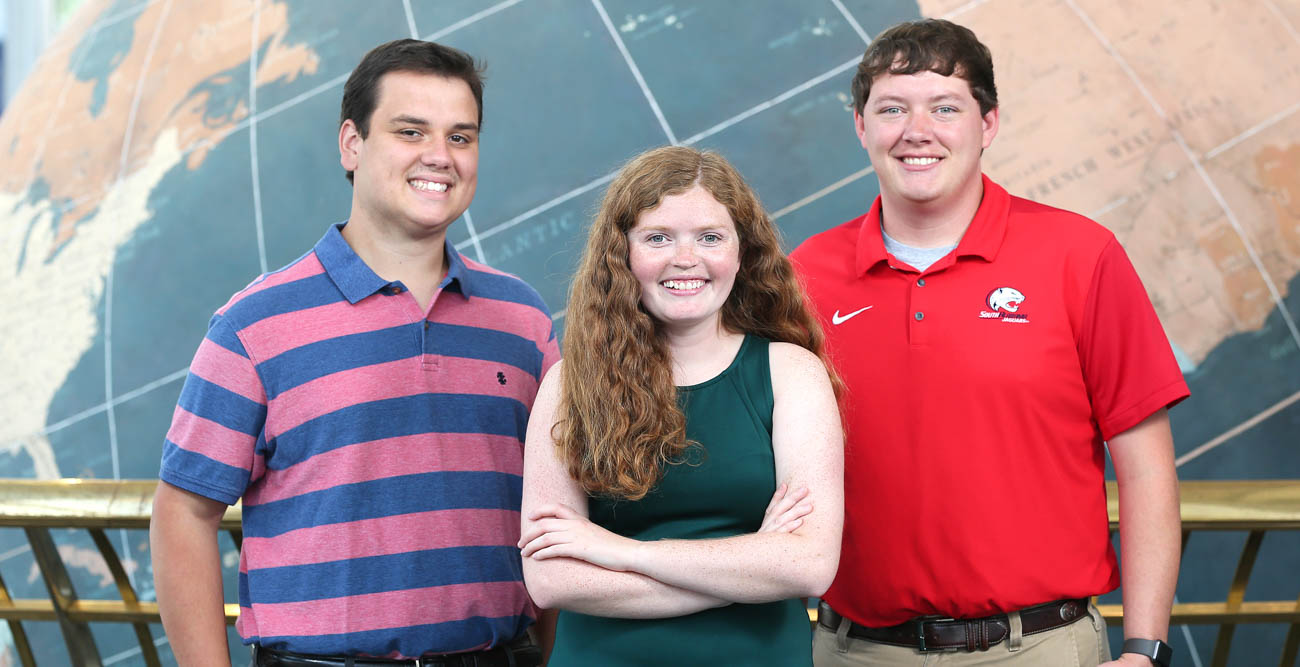 Sam Sangster, Peyton Barlow and Dillon Blount, senior meteorology majors at USA, were awarded American Meteorological Society scholarships.